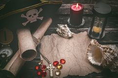 Treasure map with copy space mock up. Pirate table. Pirate captain table with crumpled paper page with copy space for treasure map, golden compass, sand watch stock photo
