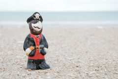 Pirate ceramic doll on beach Stock Photo