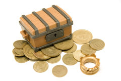 Pirate chest. Open toy pirate chest whit argentinian money and King crown over white background Royalty Free Stock Images