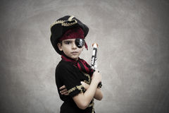 Pirate. Child pirate costume and background royalty free stock image