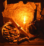Pirate coins with candle 2. Composition with candle, scroll and bottle of rum Royalty Free Stock Image