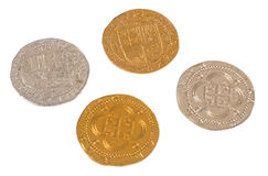 Pirate Coins. A collection of four pirate coin treasure on a pure white backdrop Stock Images
