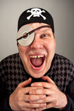 Pirate with computer disk on eye Stock Image