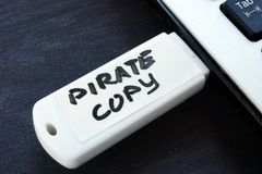 Pirate copy written on a flash drive. Copyright law. Concept royalty free stock photos
