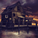 Pirate cottage and ship. Night scenery with a fantasy pirate cottage and pirate ship Royalty Free Stock Image
