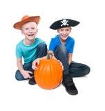 Pirate and cowboy with pumpkin - halloween theme Stock Photos