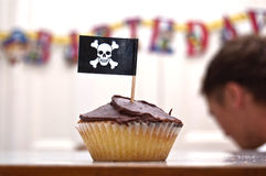 Pirate Cupcake. An image of a party pirate cupcake with a skull and crossbones flag royalty free stock photography