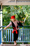 Pirate. Cute little girl dressed up as a fierce pirate and walking the plank with her sword stock image