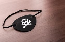 Pirate eyepatch on the table Royalty Free Stock Image