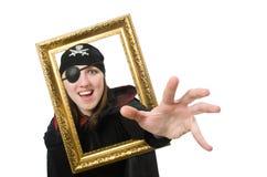 Pirate féminin dans le manteau noir tenant le cadre de photo Images stock