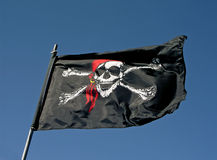 Pirate flag. Flying in the wind Stock Photo