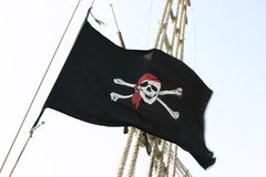 Pirate flag. In the wind on boat in the Mediterranean see Royalty Free Stock Photography
