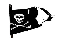 Pirate Flag. Worn torn pirate flag, blowing in the wind royalty free stock photo