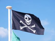 Pirate flag. A shot of a waving pirate flag Stock Photography
