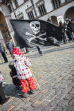 Pirate flag. A little boy holding large black pirate flag and waving with it Royalty Free Stock Photo