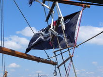 Pirate Flag. On a pirate ship with a blue sky Stock Image