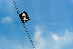 Pirate flag blue sky Royalty Free Stock Photography