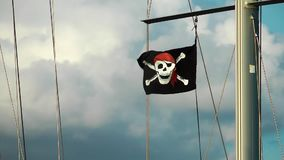 The Pirate flag on Boat. In wind video stock video