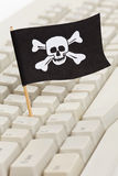 Pirate Flag and Computer Keyboard Royalty Free Stock Image