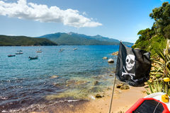 Pirate Flag in Forno beach, Elba Island. Pirate Flag in Forno beach, Biodola Bay, Elba island royalty free stock images