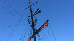 Pirate flag on a historic ship. At the Baltic Sea in Poland stock footage