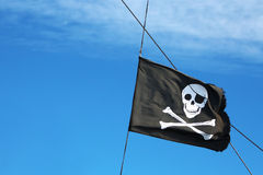 Pirate flag in the sky Royalty Free Stock Photo