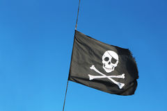 Pirate flag on the sky Stock Images