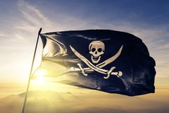 Pirate Flag flag textile cloth fabric waving on the top sunrise mist fog. Beautiful royalty free illustration