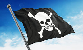 Pirate flag waving on blue background Stock Images