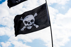Pirate flags in the wind Stock Photo