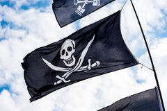 Pirate flags in the wind Royalty Free Stock Photo