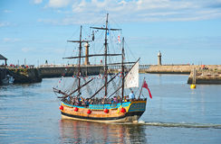 Pirate Galleon: trips round the Bay at Whitby. Pirate Galleon in the Harbor at Whitby in East Yorkshire taking holiday makers for trips around the Bay Royalty Free Stock Photo