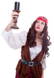 Pirate girl with a candle in hand Stock Images