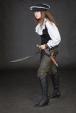 Pirate girl with pistol and saber Stock Image