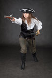 Pirate girl rush to the attack with gun Royalty Free Stock Photos
