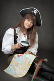 Pirate girl with sea map sit on a black Stock Photo