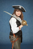 Pirate girl with sword on blue Royalty Free Stock Images