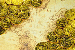 Pirate golden coin on a old world map Royalty Free Stock Photo