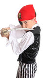 Pirate holding a cutlass sword. Pirate with a cutlass sword staring his opponent is ready for some fighting action Royalty Free Stock Photos