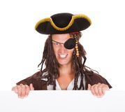 Pirate Holding Placard In Mouth Stock Photography