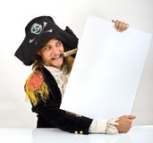 Pirate holding a sign. Pirate holding a  blank sign with knife in mouth Stock Images