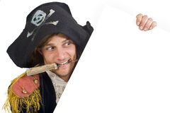 Pirate holding a sign. Pirate holding a  blank sign with knife in mouth Royalty Free Stock Photography