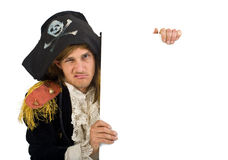 Pirate holding a sign. Pirate holding a  blank sign with knife in mouth Stock Photo