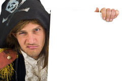 Pirate holding a sign. Pirate holding a  blank sign with knife in mouth Stock Photos