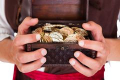 Pirate Holding Treasure Box Royalty Free Stock Images