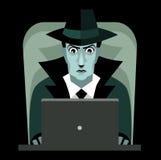 Pirate informatique avec le chapeau noir d'ordinateur Photo stock