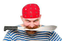 Pirate keeping a knife in his teeth. Stock Images