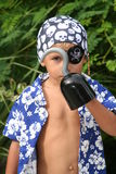 Pirate kid looking trough hook royalty free stock images