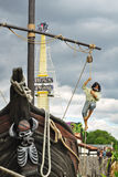 Pirate with knife in mouth climbing ship mast. Illustration of pirate bay playground, taken in Lightwater Valley amusement park, England, UK Stock Image