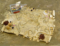 Pirate map with decorations. Composition with pirate map, decorations and ship in the glass royalty free stock photos